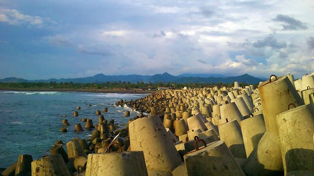 Hundreds of tetrapods lined the west side of Glagah Beach is a safety as well as an icon of the beach.