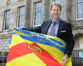 County Councillor Matthew Ellis with the Staffordshire Flag