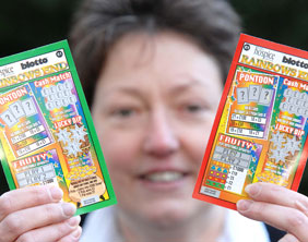 St Giles Hospice Promotions' Lesley Holmes with the Rainbow Scratchcards