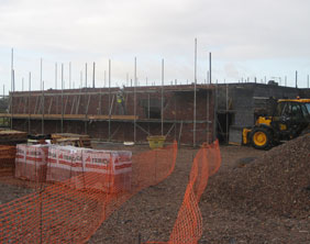 Builders on site at Darwin Hall