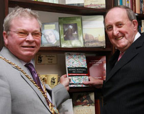 Cllr Terry Thomas receives a copy of the new book