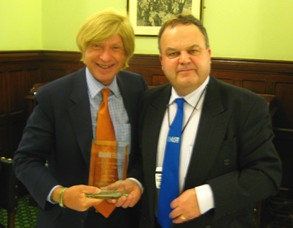 Michael Fabricant receives his award from Clive Henderson, Chairman of the Inland Waterways Association