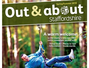 The front cover of the Out and About newspaper