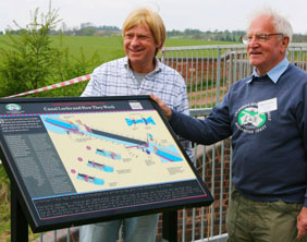 Michael Fabricant and Eric Wood with the new board