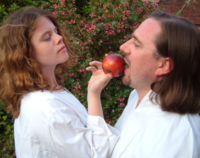 Alice Dale, as Eve, tempts Adam (with Robert Webb standing in for the actor) with an apple in A Bite of the Mysteries.