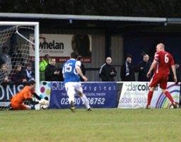 Chasetown goalkeeper Ryan Price saves. Pic: Dave Birt