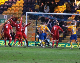 Louis Briscoe nets in controversial fashion to make it 2-1 to Mansfield Town. Pic: Dave Birt