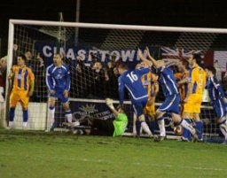 Chasetown players celebrate their last-gasp equaliser against Mansfield Town. Pic: Dave Birt
