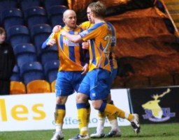 Adam Murray celebrates his goal for Mansfield Town. Pic: Dave Birt
