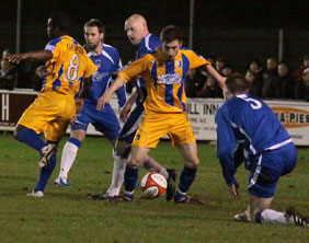 Chasetown defend in numbers against Mansfield Town. Pic: Dave Birt