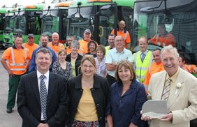 Andrew Barratt, Ruth Plant, Cllr Louise Flowith and Cllr John Garner surrounded by members of the recycling team
