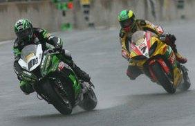 Gary Mason (left) leads the way in the rain