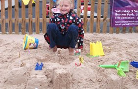 Charlotte with her winning sandcastle