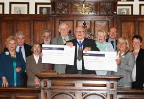 Barry Diggle hands over the cheques