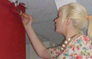Lauren Moulding paints a wall