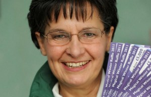 St Giles Hospice Lottery representative Roberta Jarvis with the Magical Winter Raffle tickets