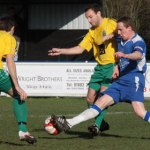 Chasetown FC's Mark Hands battles for the ball. Pic: Dave Birt