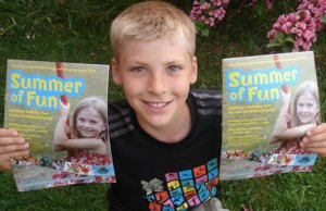 Hayden Smith with the Summer of Fun brochure