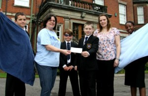 Stacey Smalley receives the cheque from Maple Hayes students