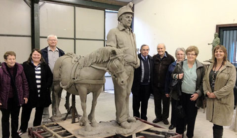 Representatives from local groups get a first look at the Scamp sculpture before it is cast