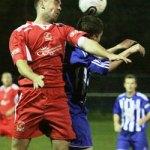 Richard Bryan heads the ball away. Pic: Dave Birt