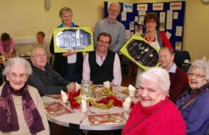 Simon Price hands over cutlery sets to Churches Together Christmas Day Lunch volunteers