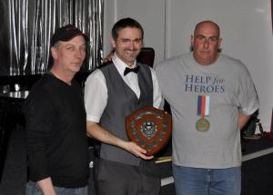 Darren Ennis collects his trophy after winning the fundraising pool tournament
