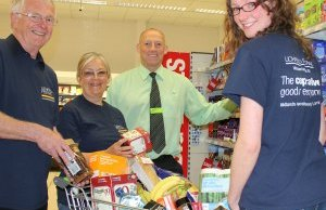 Lichfield Festival volunteers with Midlands Co-Op store manager Mark Green