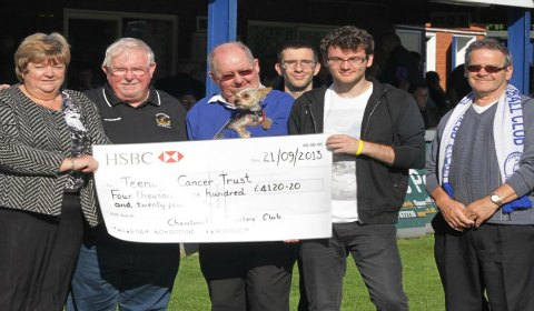 Stephen Sutton receives a fundraising cheque from Chasetown FC staff and supporters