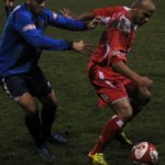 Simon Brown is closed down by a Leek defender. Pic: Pamela Mullins