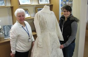 Museum volunteer Carole Griffiths shows visitor Sarah Lampet-Wood a 1960s wedding dress which will feature in the new exhibition