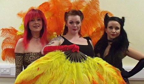 Ruth Huddleston as a demonic barman, Emma Allen as Lucifer and Ruth Adams as The Devil