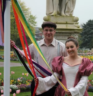 James Mayer and Katy Humpage try out their maypole skills