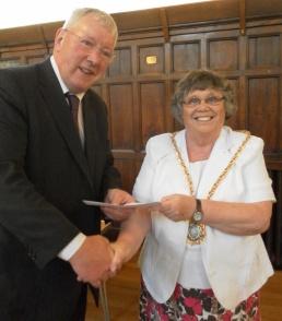 Cllr Norma Bacon, Mayor of Lichfield, presents the cheque to Colin Ablitt, board member of Lichfield Festival Ltd