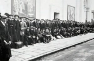Men queuing to sign up at a national recruitment centre during World War One. Pic: National Army Museum