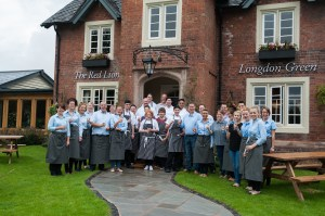 Staff celebrating the re-opening of the Red Lion, Longdon Green