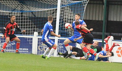 Karl Demidh squeezes the ball home past the Chasetown backline. Pic: Dave Birt