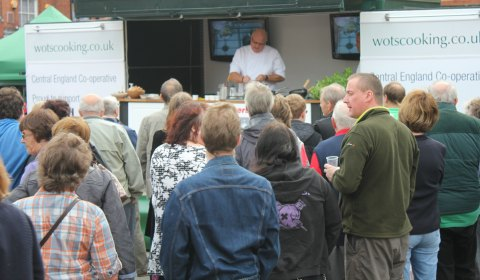 Crowds watching a cookery demonstration by Paul Gilmore