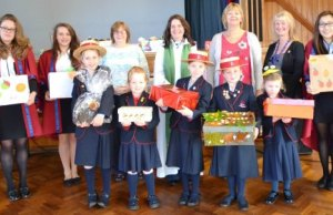 The Revd Vivienne Flanaghan with staff and pupils from Abbots Bromley School.