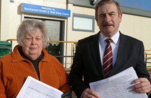 Cllr Di Evans and Cllr Don Isaacs with the petition outside the temporary health centre in Burntwood