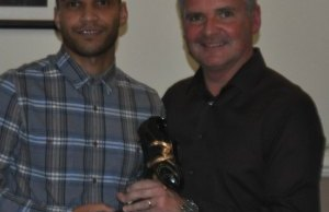 Simon Brown collects an award from Charlie Blakemore