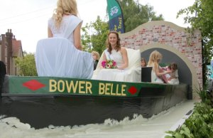 The Bower Belle 'sailing' through Lichfield city centre on Bower Day