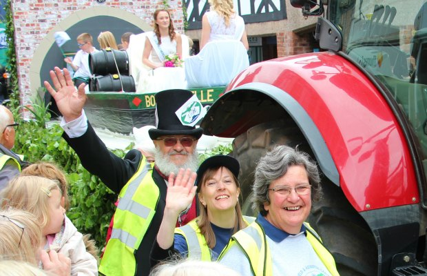 Christine Howles (bottom centre) taking part in the Lichfield Bower with the Lichfield and Hatherton Canals Restoration Trust float