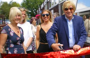 Michael Fabricant cuts the ribbon on the summer fayre in Longdon