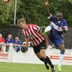 Stan Mugisha battles for the ball. Pic: Dave Birt