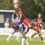 A Grantham player climbs above Nathan Waite. Pic: Dave Birt