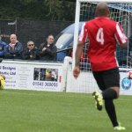 Evesham's keeper can do nothing to keep out Stan Mugisha's shot. Pic: Dave Birt