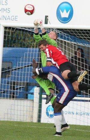 Goalkeeper John Bateman climbs highest. Pic: Dave Birt