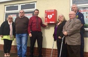 Mandi EdwardsDavid Crowe, Cllr Darren Ennis, Cllr Pamela Stokes, Cllr Keith Stokes and Paul Dadge with the new defibrillator