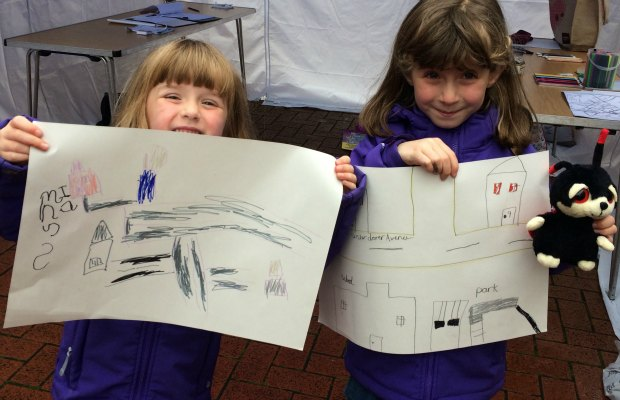 Four-year-old Ruby and seven-year-old Ellie show off their drawings
